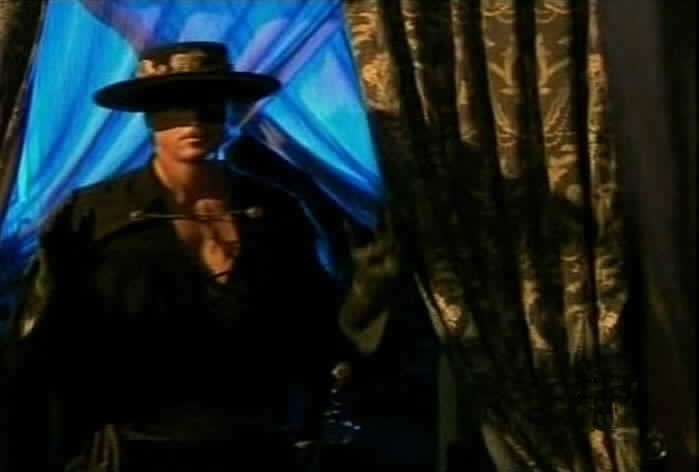 Zorro enters Esmeralda's room.